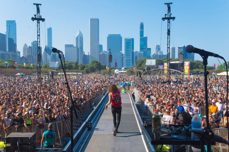 FILE – In this Aug. 4, 2019 file photo, David Shaw of The Revivalists performs on day four of Lollapalooza in Grant Park. The hordes of people expected to descend on Chicago's Grant Park for the Lollapalooza music festival starting Thursday, July 29, 2021, will be required to show proof that they've been vaccinated for COVID-19 or tested negative for the disease within the last three days. (Photo by Amy Harris/Invision/AP File)