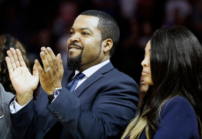 FILE – In this June 25, 2017, file photo, Big3 Basketball League founder Ice Cube applauds the crowd during a timeout in the first half of Game 2 in the league's debut at the Barclays Center in New York. Ice Cube is still looking to take his 3-on-3 basketball league to greater heights in its fourth season of play. The Big3 took the summer of 2020 off because of the pandemic. (AP Photo/Kathy Willens, File)
