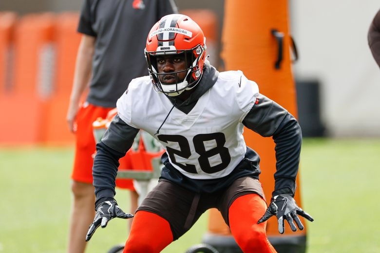 FILE – In this Wednesday, June 9, 2021 file photo, Cleveland Browns linebacker Jeremiah Owusu-Koramoah runs through a drill during an NFL football practice at the team's training facility in Berea, Ohio. Cleveland Browns rookie linebacker Jeremiah Owusu-Koramoah has tested positive with the COVID-19 virus just days before the opening of training camp. The team placed the second-round pick from Notre Dame on the COVID list Sunday, July 25, 2021.(AP Photo/Ron Schwane, File)