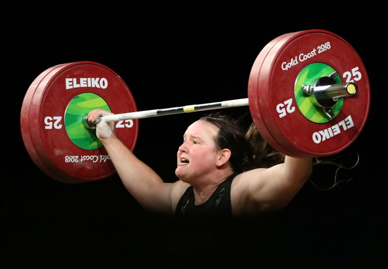 FILE – In this April 9, 2018, file photo, New Zealand's Laurel Hubbard lifts in the snatch of the women's 90kg weightlifting final at the 2018 Commonwealth Games on the Gold Coast, Australia. Hubbard, a transgender woman, is competing in weightlifting for New Zealand (AP Photo/Mark Schiefelbein, File)