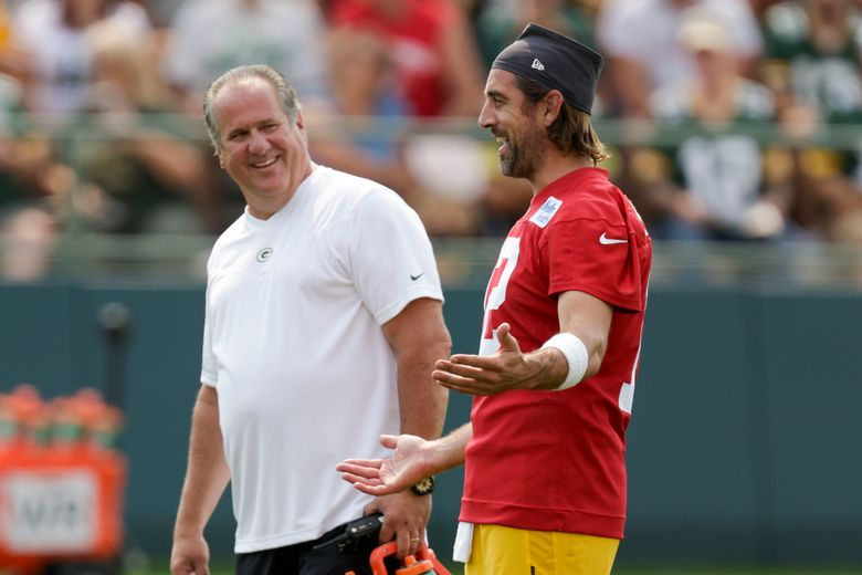 CORRECTS MONTH TO JULY, NOT AUG. – Green Bay Packers' quarterback Aaron Rodgers has a laugh with assistant athletic trainer Kurt Fielding during NFL football training camp Wednesday, July 28, 2021, in Green Bay, Wis. (AP Photo/Matt Ludtke)