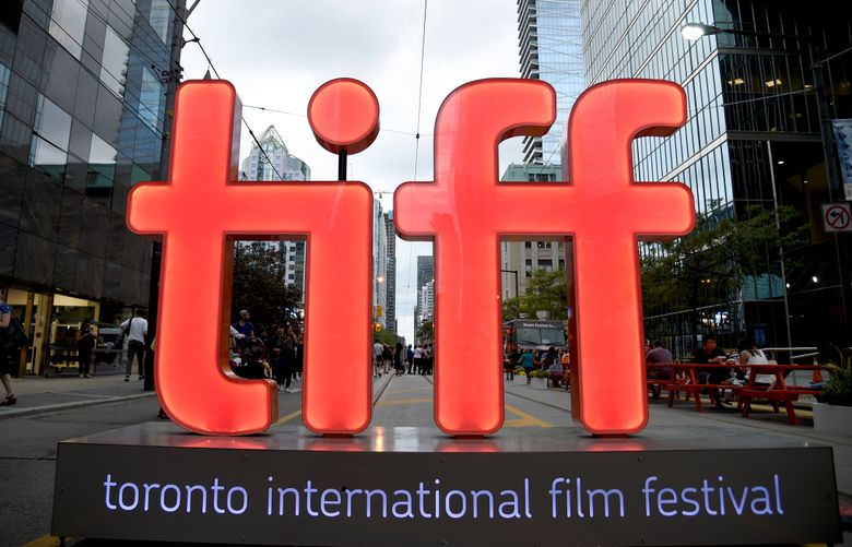 """FILE – In this Thursday, Sept. 6, 2018, file photo, a view of a festival sign appears on Day 1 of the Toronto International Film Festival in Toronto.  Organizers announced Tuesday, July 20, 2021, that among the films that premiere at this year's TIFF will be the adaptation of the Tony-winner """"Dear Evan Hansen,"""" which will open the festival, Edgar Wright's '60s London themed """"Last Night in Soho,"""" and """"The Eyes of Tammy Faye."""" TIFF runs Sept. 9-18.  (Photo by Chris Pizzello/Invision/AP, File)"""