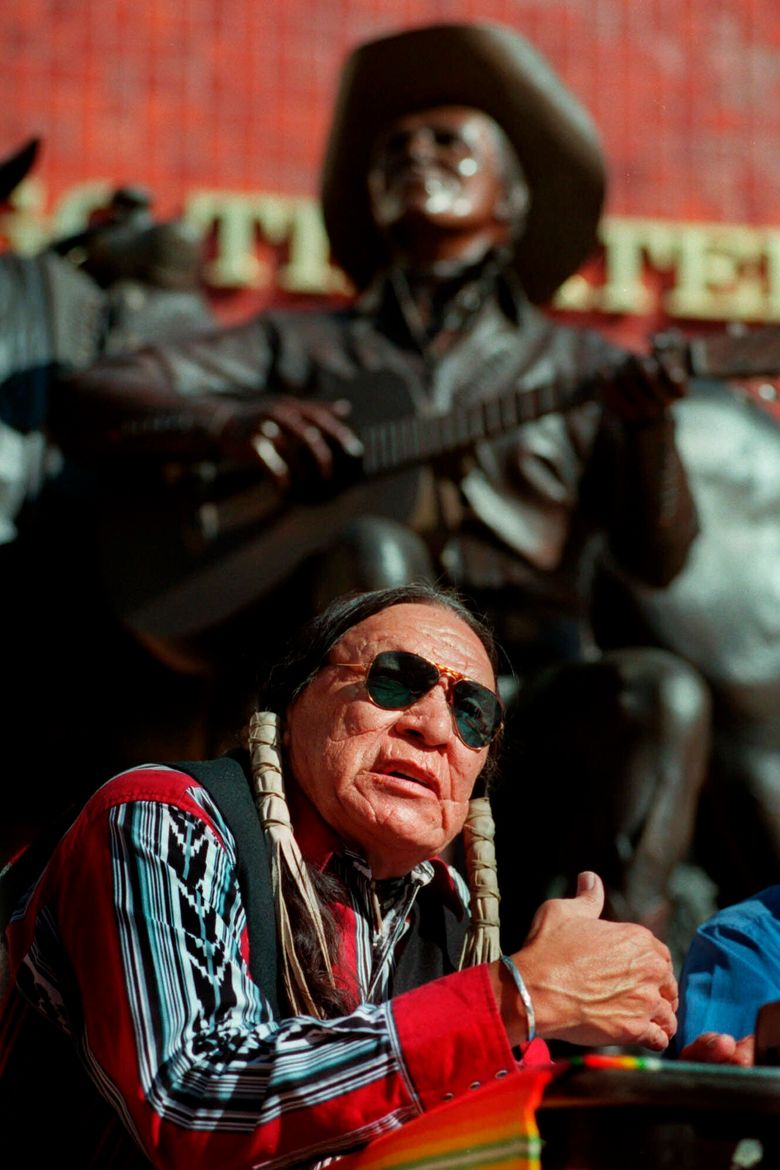 FILE – In this Feb. 18, 2000 file photo, Saginaw Grant, veteran actor and writer, responds to a question during a news confernce, at the Gene Autry Museum in Los Angeles. Grant, a prolific Native American character actor and hereditary chief of the Sac & Fox Nation of Oklahoma, has died. He was 85. Grant's publicist, Lani Carmichael, says Grant died peacefully in his sleep of natural causes on Wednesday, July 28, 2021, at a private-care facility in Hollywood, California. (AP Photo/E.J. Flynn File)