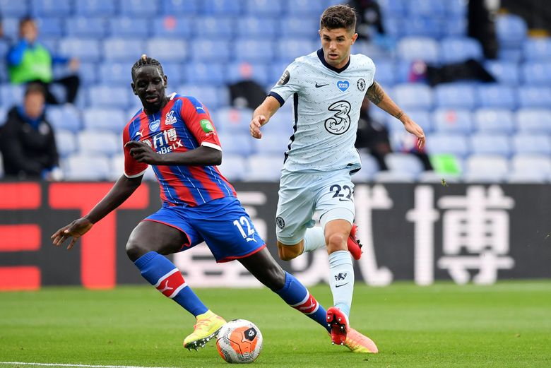 FILE – In this Tuesday, July 7, 2020 file photo, Crystal Palace's Mamadou Sakho, left, and Chelsea's Christian Pulisic in action during the English Premier League soccer match between Crystal Palace and Burnley at Selhurst Park, in London, England. Center-back Mamadou Sakho signed with French club Montpellier on Tuesday July 27, 2021, after playing eight seasons in the Premier League. (Justin Tallis/Pool via AP, File)