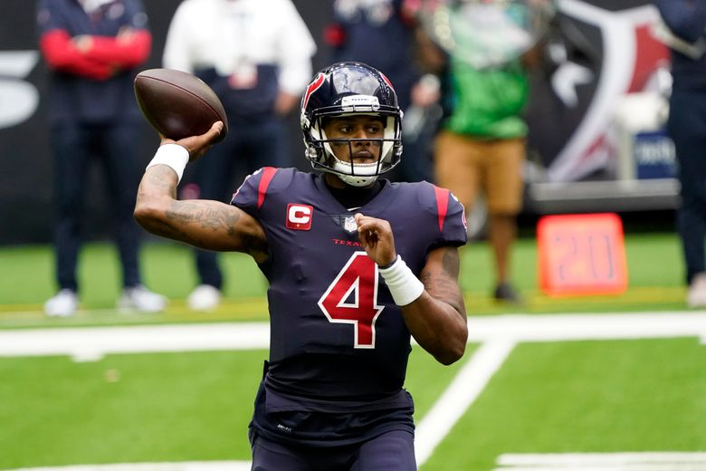 File-This Dec. 27, 2020, file photo shows Houston Texans quarterback Deshaun Watson (4) throwing a pass against the Cincinnati Bengals during the first half of an NFL football game in Houston. Watson plans to report to training camp with the Houston Texans. (AP Photo/Sam Craft, File)