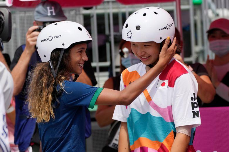 Silver medalist Rayssa Leal of Brazil, left, congratulates gold medal winner Momiji Nishiya of Japan after winning the women's street skateboarding finals at the 2020 Summer Olympics, Monday, July 26, 2021, in Tokyo, Japan. (Ben Curtis / AP)