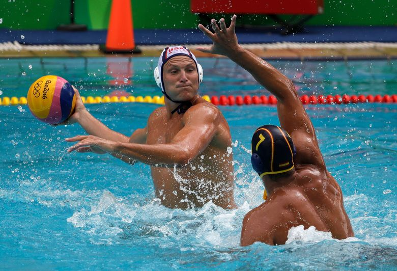 FILE – In this Aug. 8, 2016, file photo, United States' Jesse Smith, left, shoots as Spain's Balasz Sziranyi Somogyi defends during their men's water polo preliminary round match at the Summer Olympics in Rio de Janeiro, Brazil. Smith is heading to his record-tying fifth Olympics after he was selected Friday, July 2, 2021, for the U.S. men's water polo team for the Tokyo Games. (AP Photo/Eduardo Verdugo, File)
