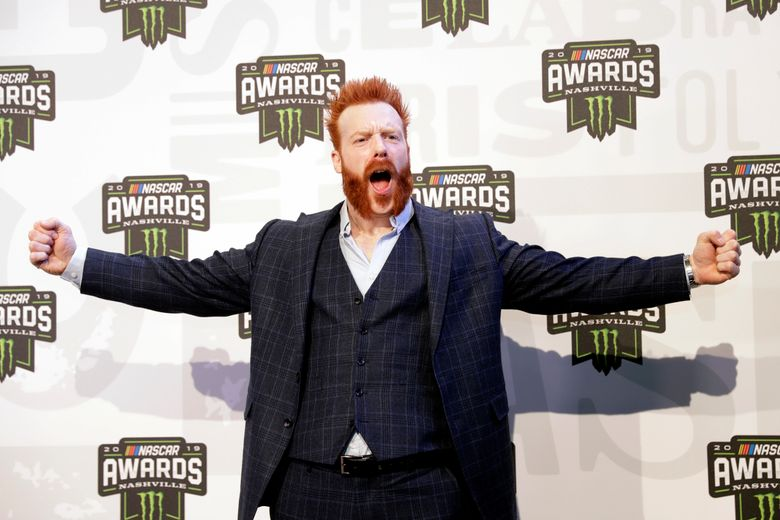 """FILE – In this Dec. 5, 2019 file photo, professional wrestler and actor Sheamus arrives at the NASCAR Cup Series Awards in Nashville, Tenn. The WWE star is offering ring-side seats and """"many beers"""" to anyone who returns a prop cross necklace that was stolen in May 2021 from an arena on the campus of the University of South Florida. Crime Stoppers of Tampa Bay is also offering a $5,000 reward for information about the theft of the necklace, three title belts signed by various WWE stars and a corner pad. Police say the theft happened in the early morning hours of May 22 at the Yuengling Center. (AP Photo/Mark Humphrey, File)"""