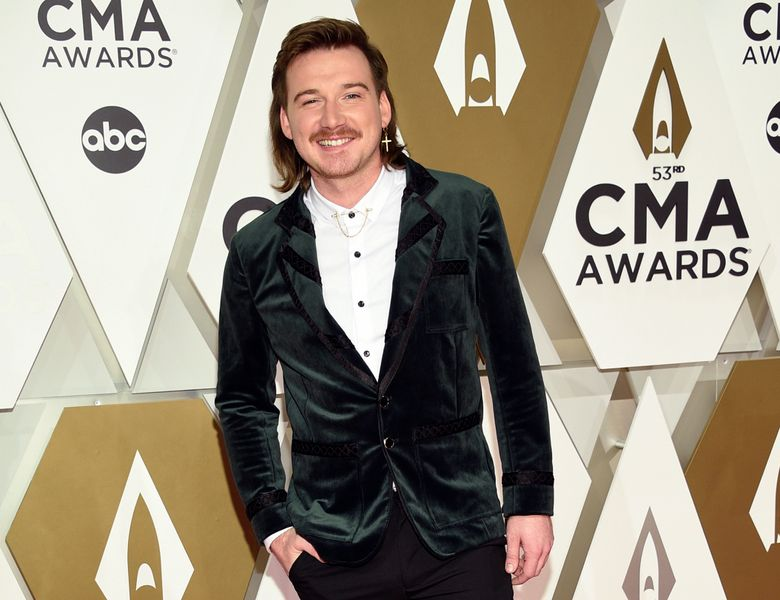 """FILE – Morgan Wallen arrives at the 53rd annual CMA Awards on Nov. 13, 2019, in Nashville, Tenn.   Wallen said it was ignorant of him to use a racial slur. In his first interview in six months, Wallen talked to Michael Strahan on ABC's """"Good Morning America."""" on Friday, July 23, 2021.    (Photo by Evan Agostini/Invision/AP, File)"""