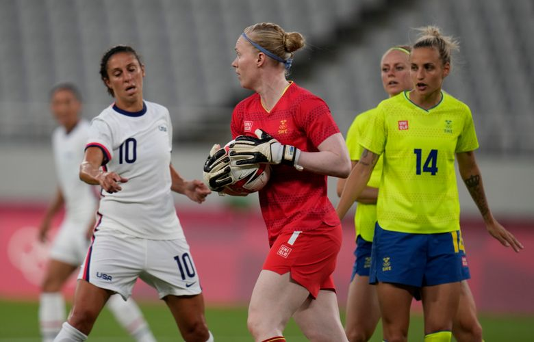 Sweden's goalkeeper Hedvig Lindahl, center, catches the ball during a women's soccer match against United States at the 2020 Summer Olympics, Wednesday, July 21, 2021, in Tokyo. (AP Photo/Ricardo Mazalan)