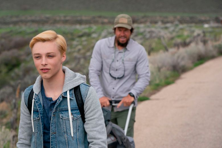 """This image provided by Roadside Attractions shows Reid Miller, left, portraying Jadin Bell, and Mark Wahlberg, portraying Bell's father in a scene from the film """"Joe Bell.""""  (Quantrell D. Colbert/ Roadside Attractions via AP)"""