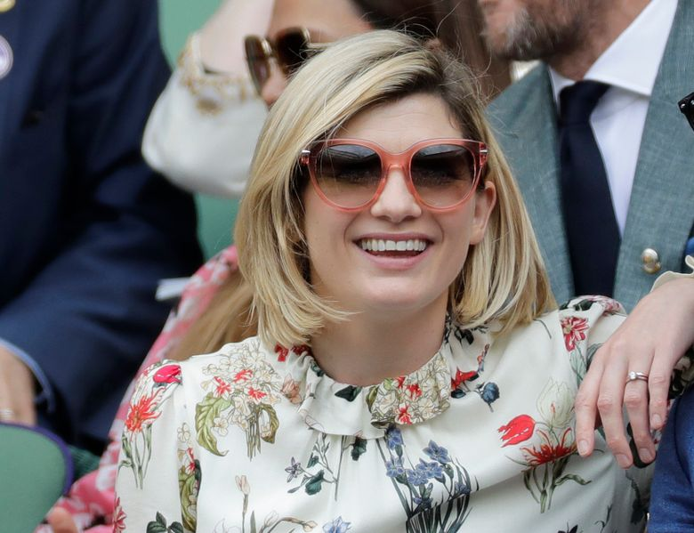FILE – In this file photo dated Saturday, July 13, 2019, actress Jodie Whittaker sits in the Royal Box on Centre Court to watch the women's singles final match between Serena Williams of the United States and Romania's Simona Halep on day twelve of the Wimbledon Tennis Championships in London.  The BBC said Thursday July 29, 2021, that star Jodie Whittaker will leave the Doctor Who science fiction series next year, but before leaving Whittaker will appear in a new six-episode series in 2021 and three special episodes in 2022.(AP Photo/Ben Curtis, FILE)