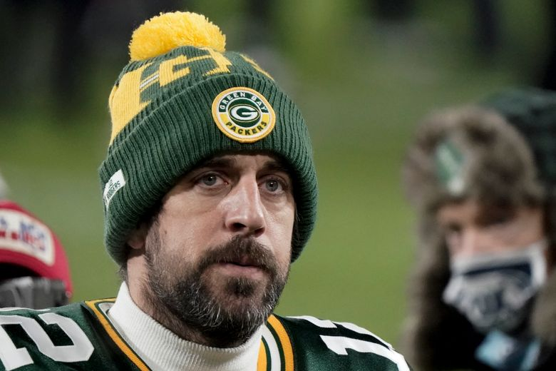 FILE – In this Sunday, Jan. 24, 2021, file photo, Green Bay Packers quarterback Aaron Rodgers (12) walks off the field after the NFC championship NFL football game against the Tampa Bay Buccaneers in Green Bay, Wis.  In a news conference, Monday, July 5, 2021, reigning NFL MVP Rodgers said he has spent this offseason focusing on improving himself in every respect, and that goes beyond making sure he's in top physical shape. (AP Photo/Morry Gash, File)