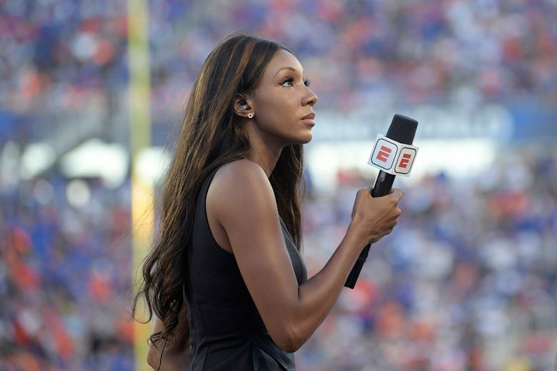 """FILE – In this Aug. 24, 2019, file photo, ESPN's Maria Taylor works from the sideline during the first half of an NCAA college football game between Miami and Florida in Orlando, Fla. Taylor is leaving ESPN after the two sides were unable to reach an agreement on a contract extension. Taylor had been with ESPN since 2014 but her contract expired Tuesday, July 20, 2021. Her last assignment for the network was Tuesday night at the NBA Finals, where she was the pregame and postgame host for the network's """"NBA Countdown"""" show.  (AP Photo/Phelan M. Ebenhack, File)"""