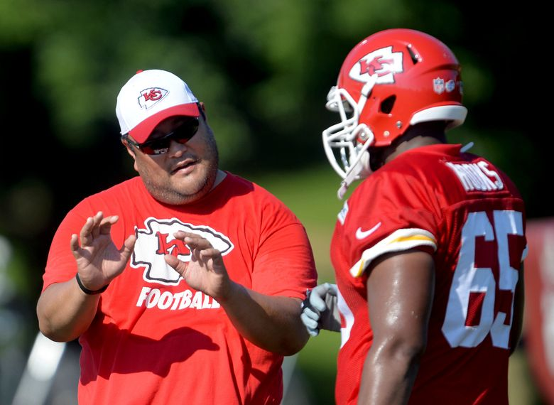 FILE – Then-Kansas City Chiefs assistant offensive line coach Eugene Chung, left, talks with lineman Tavon Rooks (65) during NFL football training camp practice n St. Joseph, Mo., in this Sunday, Aug. 2, 2015, file photo. Former NFL player and coach Eugene Chung is still waiting to meet with Commissioner Roger Goodell regarding an anti-Asian comment he says a team made about him during a job interview this year. Chung said on a conference call Monday, July 26, 2021, that he never was told by the league why a requested meeting with Goodell was not arranged nor how the NFL's investigation was conducted. (Andrew Carpenean/The St. Joseph News-Press via AP, File)