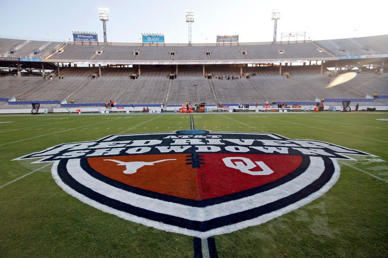 """FILE – In this Oct. 10, 2020, file photo, The Red River Showdown logo is displayed on the field of the Cotton Bowl, prior to an NCAA college football game between the University of Texas and Oklahoma, in Dallas. Texas and Oklahoma made a request Tuesday, July 27, 2021, to join the Southeastern Conference — in 2025 —- with SEC Commissioner Greg Sankey saying the league would consider it in the """"near future."""" (AP Photo/Michael Ainsworth, File)"""
