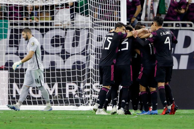 Mexico celebrates a goal by midfielder Orbelin Pineda as Canada goalkeeper Maxime Crepeau, left, walks away during the first half of a CONCACAF Gold Cup soccer semifinal Thursday, July 29, 2021, in Houston. (AP Photo/Michael Wyke)
