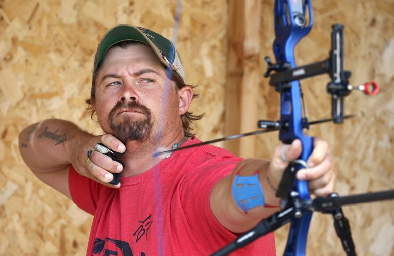 FILE – U.S. Olympic Team archer Brady Ellison lets an arrow fly as he practices on his range in Miami, Ariz., in this Thursday, April 30, 2020, file photo. Ellison is the top-ranked archer in the the world and the favorite at the Tokyo Games. A few years ago, he wasn't sure if he would even shoot another arrow again. (AP Photo/Ross D. Franklin, File)