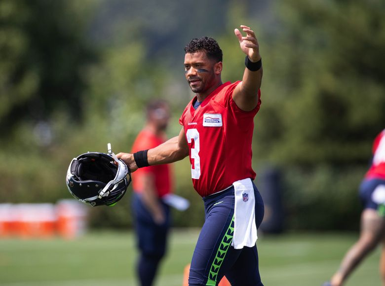 Russell Wilson has little trouble getting the 12's pumped up as camp gets underway Monday. The Seattle Seahawks practiced Monday, August 2, 2021 at the VMAC in Renton, WA. (Dean Rutz / The Seattle Times)