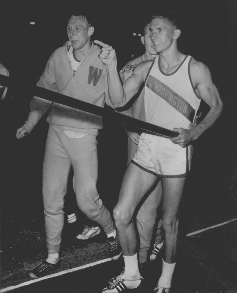 Brian Sternberg, right, smiled after officials measured his world-record pole vault at 16-feet, 7-inches in Modesto, Calif., in 1963. Congratulating Sternberg is friend and teammate Phil Shinnick, left, who competed in the long jump during the event. (AP Photos)