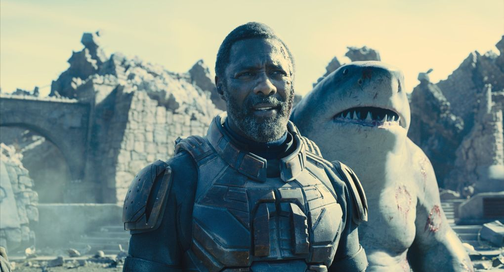 """Bloodsport (Idris Elba) and King Shark (mumbles and grumbles by Sylvester Stallone) in """"The Suicide Squad."""" (Warner Bros. Pictures / DC Comics)"""
