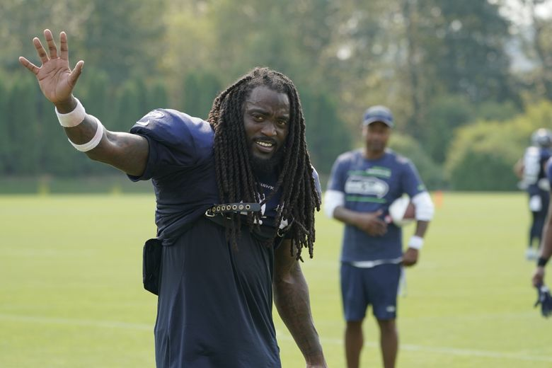Seattle Seahawks running back Alex Collins waves to fans after NFL football practice Tuesday, Aug. 3, 2021, in Renton, Wash. (Ted S. Warren / The Associated Press)