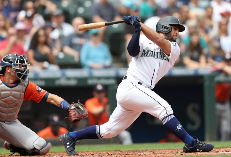 Abraham Toro of the Mariners hits a single against the Astros, Wednesday, July 28, 2021 in Seattle. (Ken Lambert / The Seattle Times)