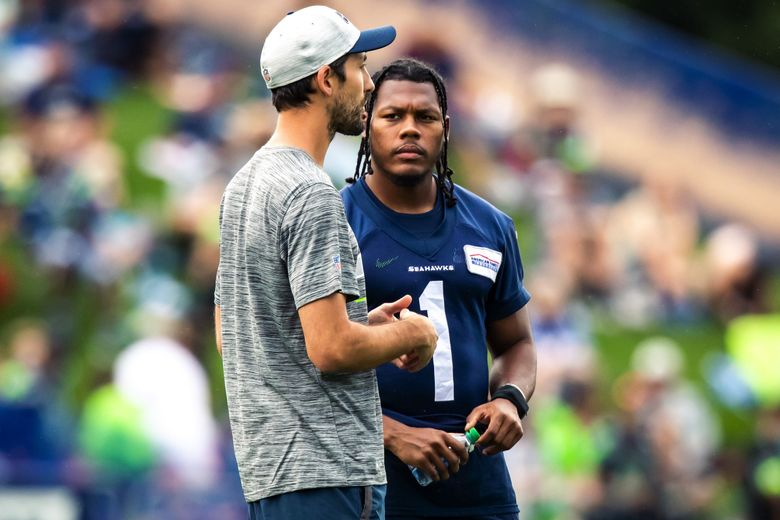 Wide receivers coach Nate Carroll, left, talks with wide receiver D'Wayne Eskridge during Seahawks Training Camp at the Virginia Mason Athletic Center in Renton Saturday July 31, 2021. (Bettina Hansen / The Seattle Times)