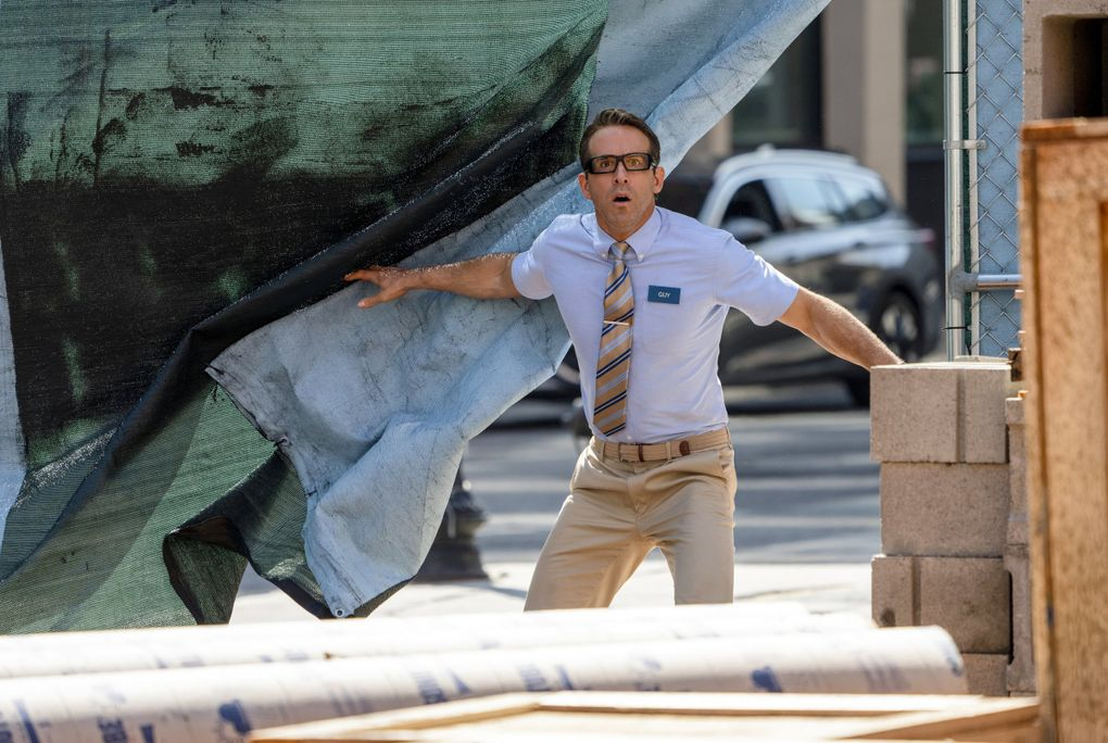 """This image released by 20th Century Studios shows Ryan Reynolds in a scene from """"Free Guy."""" (Alan Markfield / 20th Century Studios via The Associated Press)"""