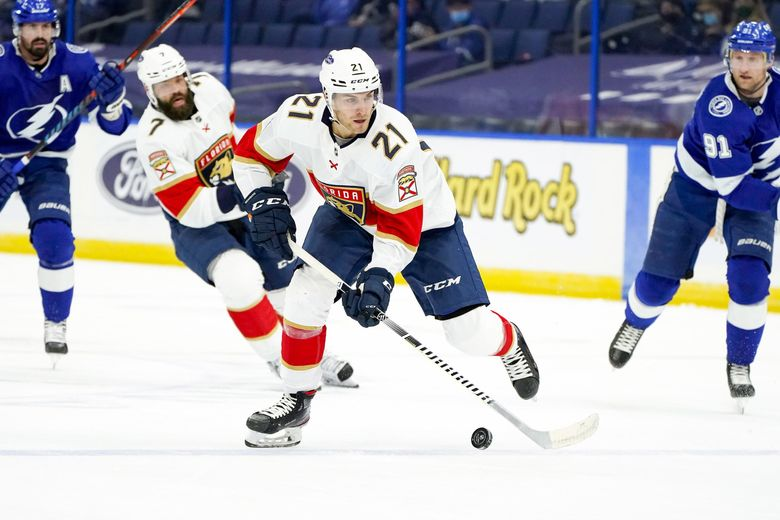 Florida Panthers center Alex Wennberg (21) carries the puck against the Tampa Bay Lightning during a game, March 21, 2021, in Tampa, Fla. (Chris O'Meara / AP)