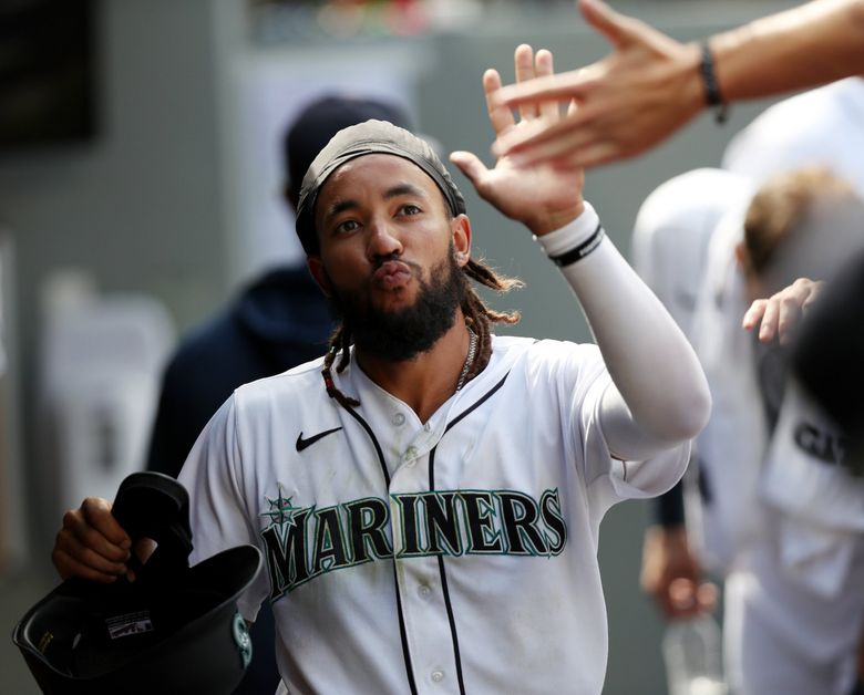 J.P. Crawford celebrates in the dugout after scoring against the Astros, July 28, 2021 in Seattle. (Ken Lambert / The Seattle Times)