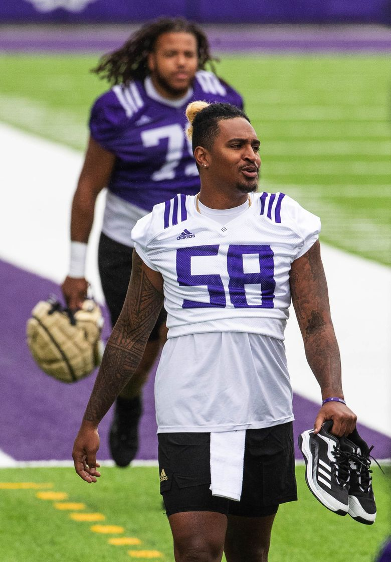 Zion Tupuola-Fetui (58) heads to practice as the Washington Huskies opened fall camp Friday, August 6, 2021. (Dean Rutz / The Seattle Times)
