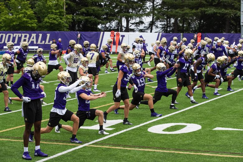 The Washington Huskies opened fall camp Friday, August 6, 2021. (Dean Rutz / The Seattle Times)