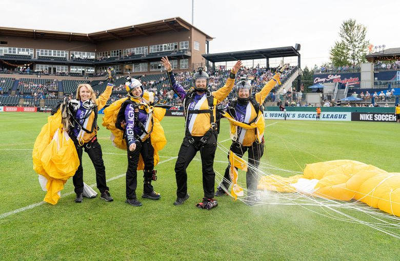 Left to right are Kaz Sheekey, Amy Chmelecki, Keri Bell and Melanie Curtis. The all-women skydiving team made an appearance at a recent OL Reign game. (David Wybenga – D Squared / )