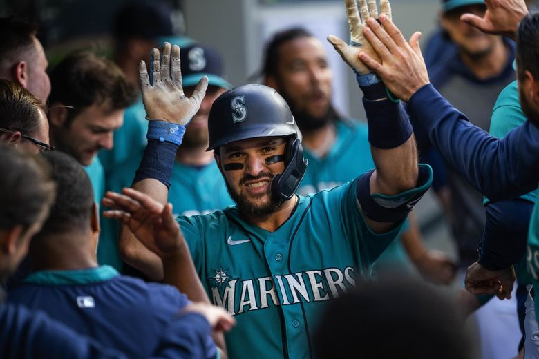 Luis Torrens is back in the Mariners dugout following his solo home run in the 2nd. The Oakland Athletics played the Seattle Mariners in Major League Baseball Friday, July 23, 2021 at T-Mobile Park in Seattle, WA. (Dean Rutz / The Seattle Times)
