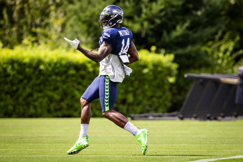 Seahawks wide receiver DK Metcalf sprints after a catch during Seahawks training camp at the Virginia Mason Athletic Center in Renton Saturday, August 7, 2021. (Bettina Hansen / The Seattle Times)