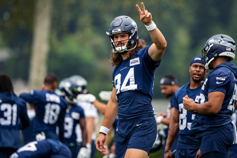 Seahawks tight end Colby Parkinson acknowledges fans cheering him on during Seahawks Training Camp at the Virginia Mason Athletic Center in Renton Saturday July 31, 2021. (Bettina Hansen / The Seattle Times)