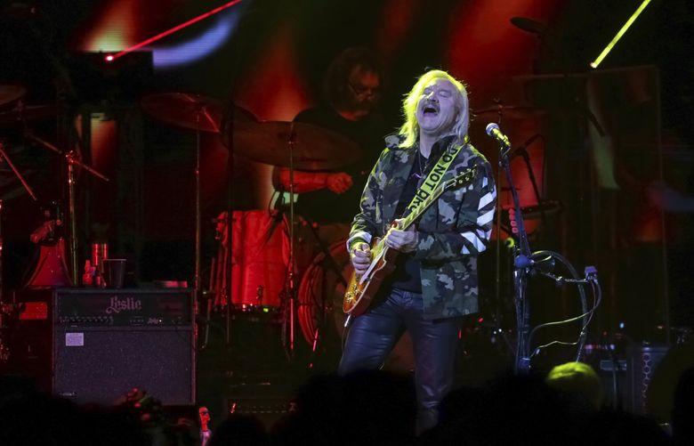 Eagles member Joe Walsh performs during the Joe Walsh and Friends VetsAid Concert at the Eagle Bank Arena in Fairfax, Virginia. Last time Walsh was in the Seattle area was when he brought the VetsAid concert to Tacoma Dome in 2018. The Eagles plan to play Climate Pledge Arena in November. (Brent N. Clarke / Invision, 2017)