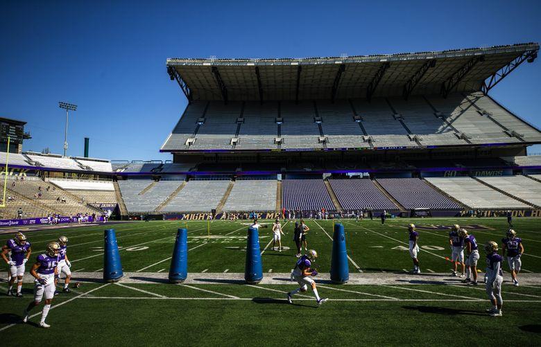 The University of Washington Huskies participate in spring practice at Husky Stadium Saturday April 17, 2021 in Seattle. (Bettina Hansen / The Seattle Times)
