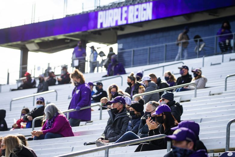 Fans were allowed to attend for the first time this season as the University of Washington Huskies participate in their spring football practice, April 10, 2021 in Seattle. (Bettina Hansen / The Seattle Times)