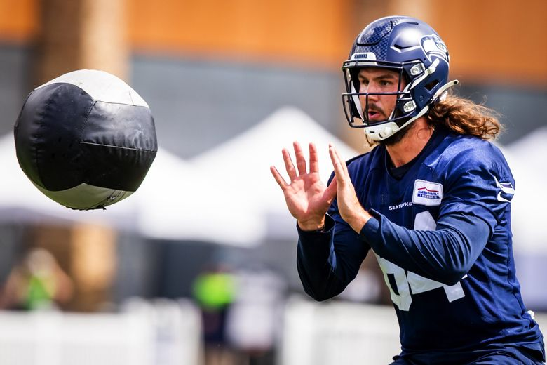 Seahawks tight end Colby Parkinson does blocking drills during Seahawks Training Camp at the Virginia Mason Athletic Center in Renton Friday, August 6, 2021. (Bettina Hansen / The Seattle Times)