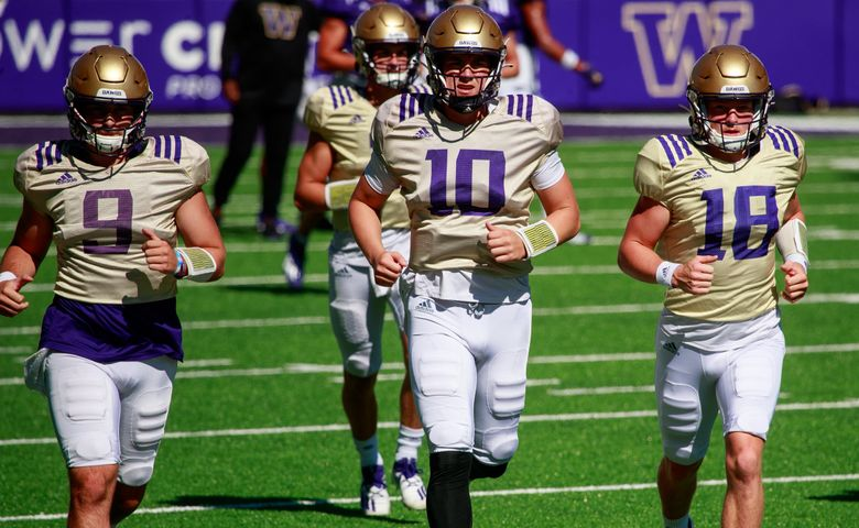 Dylan Morris (9), Patrick O'Brien (10) and Camden Sirmon (18) attend University of Washington football practice Tuesday, Aug. 10, 2021 in Seattle. 217850 (Erika Schultz / The Seattle Times)