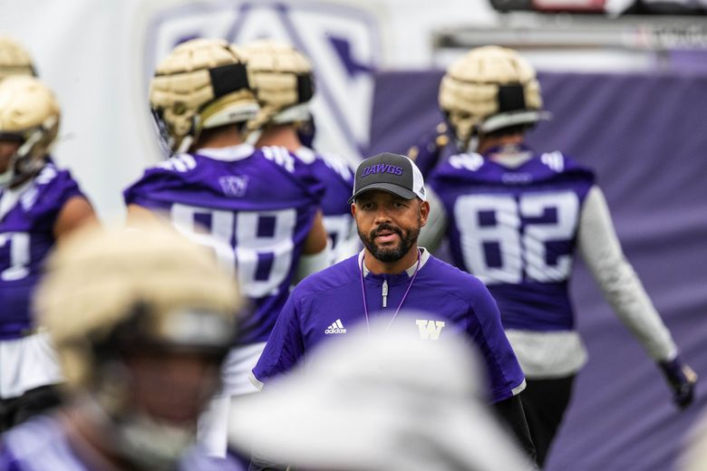 Jimmy Lake takes his Huskies through practice during camp, Aug. 6, 2021. (Dean Rutz / The Seattle Times)