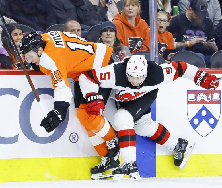 New Jersey Devils' Connor Carrick, right, collides with Philadelphia Flyers' Tyler Pitlick during a game, Feb. 6, 2020, in Philadelphia. (Matt Slocum / AP)