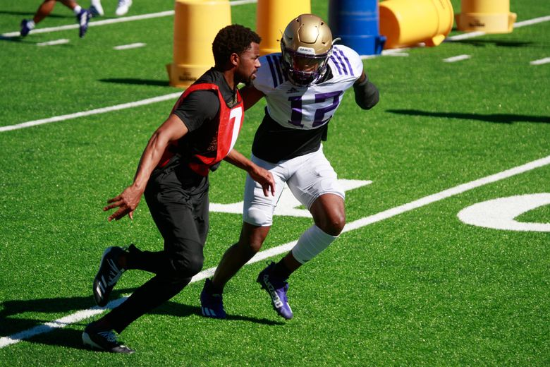 Defensive back Jacobe Covington (12) participates in drills at University of Washington football practice Wednesday, Aug. 11, 2021 in Seattle.   217850 (Erika Schultz / The Seattle Times)