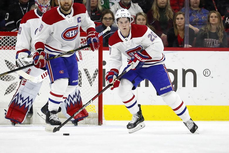 Montreal Canadiens' Cale Fleury (20) looks to pass the puck against the Carolina Hurricanes during a NHL game in Raleigh, N.C., in 2019. (Karl B DeBlaker / AP)