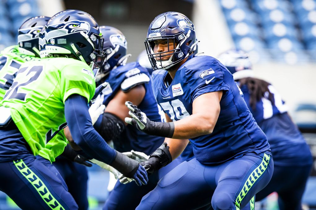 Seahawks offensive tackle Stone Forsythe warms up with the offensive line before a mock game at Lumen Field in Seattle, Aug. 8, 2021. (Bettina Hansen / The Seattle Times)
