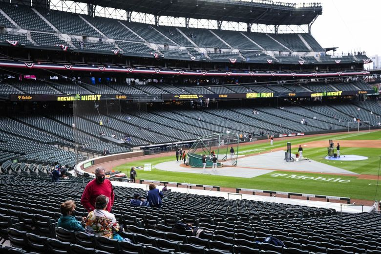 The Mariners get in some early work before a game in April. (Dean Rutz / The Seattle Times)