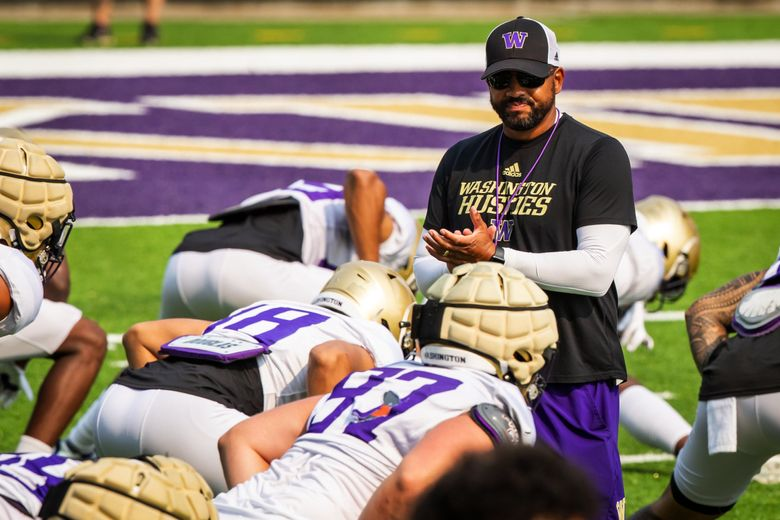 Head coach Jimmy Lake applauds as the University of Washington Huskies practice during fall camp at Husky Stadium in Seattle Saturday August 14, 2021. (Bettina Hansen / The Seattle Times)