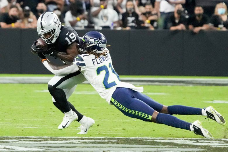 Seattle Seahawks cornerback Tre Flowers tackles Las Vegas Raiders wide receiver DJ Turner during the first half of a a preseason game, Saturday, Aug. 14, 2021, in Las Vegas. (Rick Scuteri / AP)